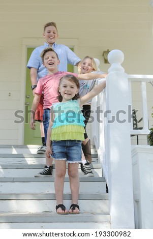 Small Children Enjoying a Fashionable Outdoor Birthday Party