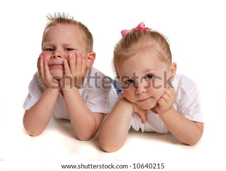 small children looking into the camera - stock photo