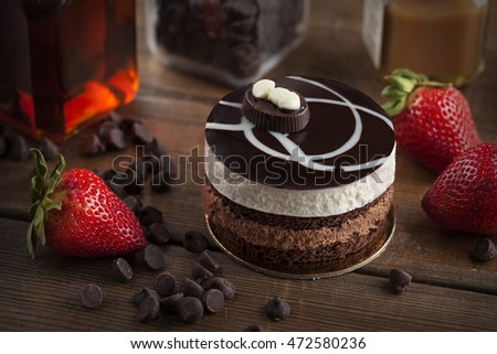 small chocolate mousse cake with strawberry