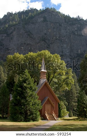 Small church at the base of a sheer wall of granite, in Yosemite Valley.
