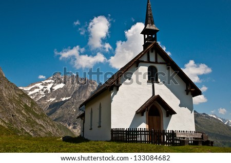 Small church/chapel in the swiss mountains - stock photo