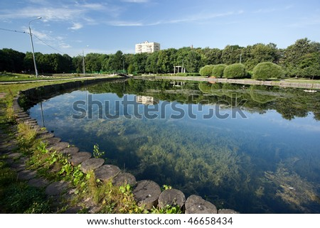Small city pond in park early in the morning