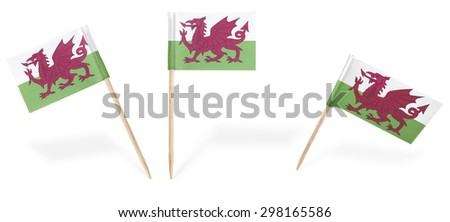 Small cocktail flags of Wales in different positions isolated on white.(series) . Also easy to use as a design element :)  - stock photo