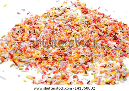 Small colored sugar sprinkles isolated on white background. Used as a decoration or to add texture to cupcakes, cookies, cakes, doughnuts, ice cream, frozen yogurt and puddings.  - stock photo