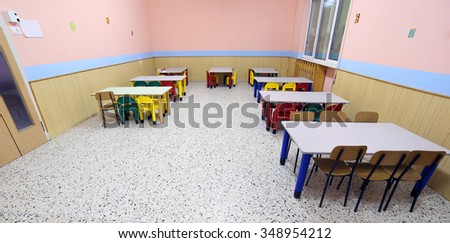 small colored tables and chairs in the dining room of the nursery canteen