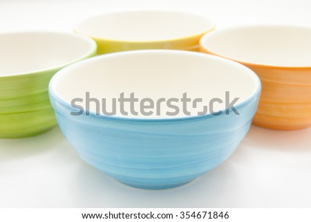 Small colorful ceramic bowl isolated over the white background - stock photo