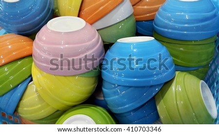 Small colorful ceramic bowl upside down in basket - stock photo