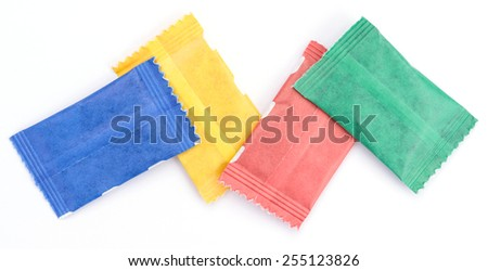 small colorful packets. blue, yellow, red and green blank pacets. isolated on white background.
