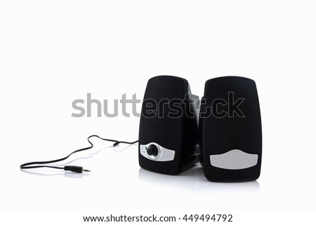 Small computer speakers on white background.