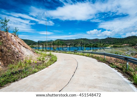 Small concrete road in country, Thailand - stock photo