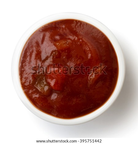 Small condiment bowl of  tomato and red chilli pepper salsa. Isolated on white from above.
