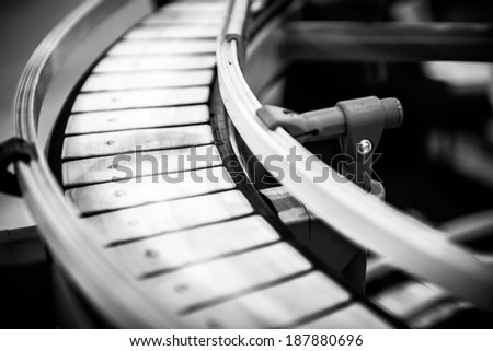Small conveyor belt closeup photo in black and white - stock photo