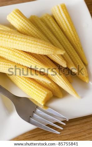 small corn on plate - stock photo