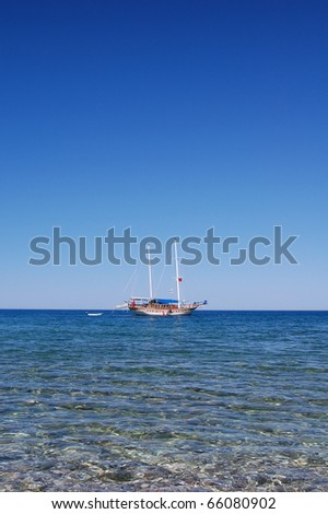 Small cost over clear water close to the coast - stock photo
