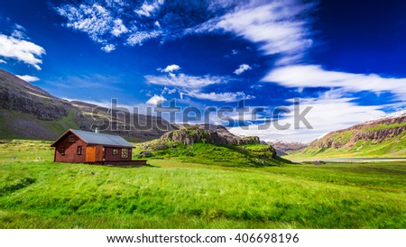 Small cottage in the mountains in Iceland - stock photo