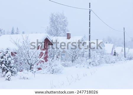 Small cottages covered in snow - stock photo