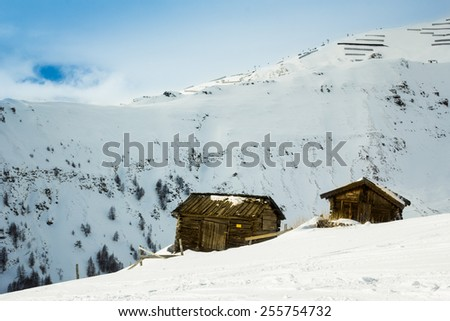 Small cottages in the mountains - stock photo