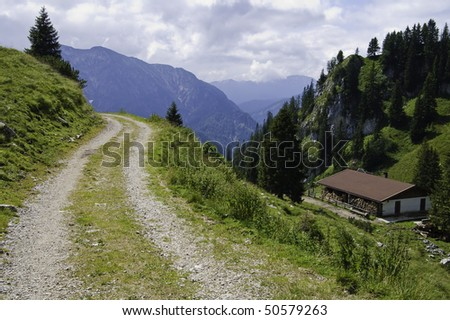 small country road in the bavarian alps of Germany - stock photo
