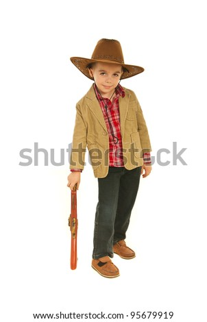 Small cowboy resting his hand on a weapon toy isolated on white background