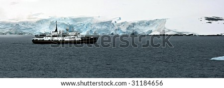 Small cruise ship in the Antarctic - stock photo