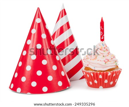 Small cupcake with candle and red party hat - stock photo