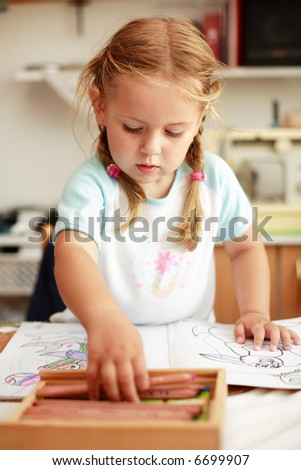 Small cute girl painting
