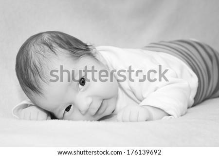 Small cute newborn baby black and white photo - stock photo
