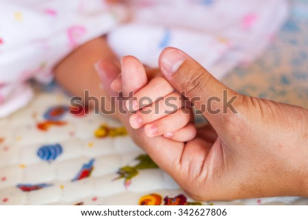 Small delicate little hand of newborn - close portrait
