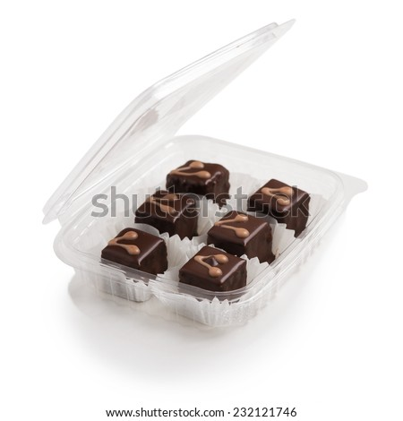 Small delicious cakes in box - stock photo