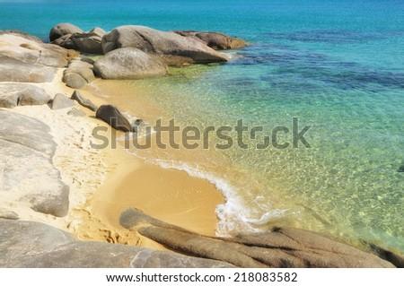 Small deserted sandy beach on Sithonia, Chalkidiki, Greece - stock photo