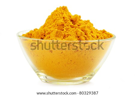 Small dish with turmeric isolated on white - stock photo
