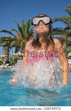 small diver girl near the beach - stock photo