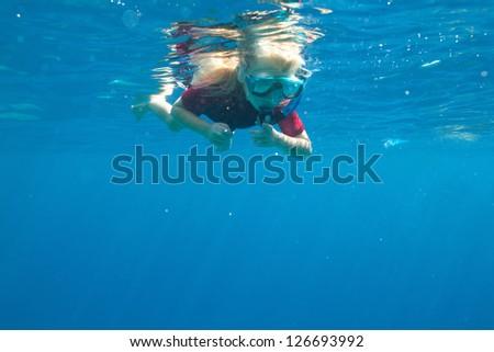 small diver underwater - stock photo