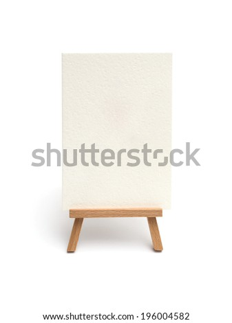 Small easel with sheet of paper isolated on white - stock photo