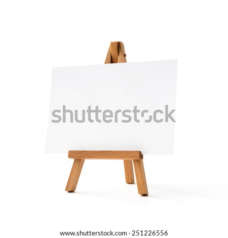 Small easel with white album sheet of paper - stock photo