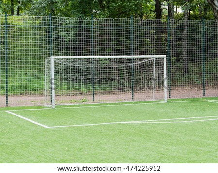 Small empty soccer field with goal post and marking