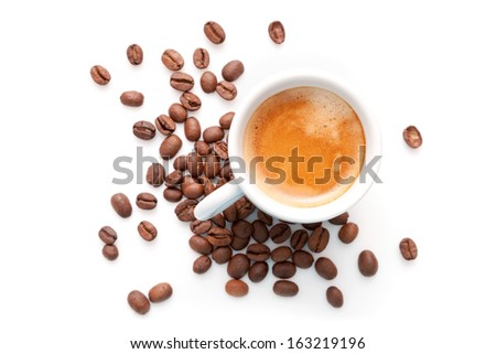 Small espresso cup with coffee beans isolated on white background - stock photo