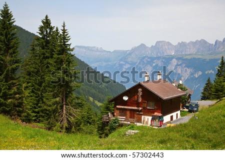 Small farm in the swiss alps - stock photo