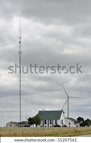 Small Farmhouse Towered By A Wind Turbine And Antanea Gives Off The Feel Of  U0027not