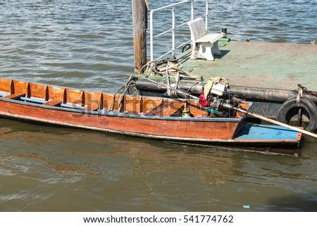 Small fast wooden boat on a river with single engine