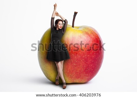 small female staying near giant apple; woman on diet, young beautiful girl staying by big fruit, healthy lifestyle of young people, - stock photo