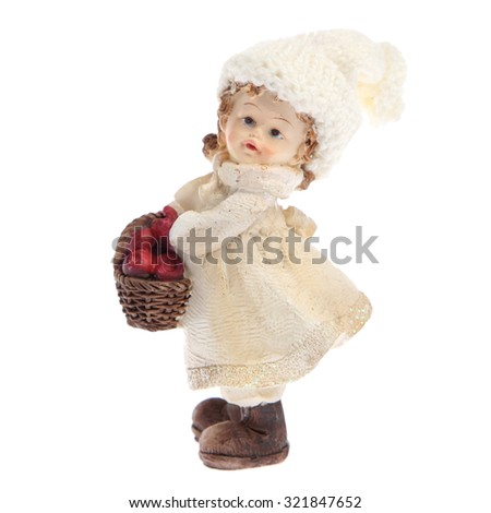 Small figurine girl with a basket of apples
