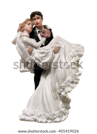 small figurines depicting bride in the arms of the groom