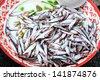 Small fish in tray sidewalk market - stock photo