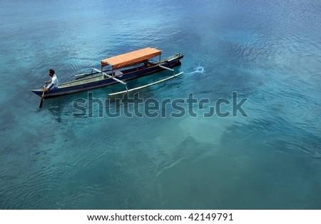 Small fisherman boat. Indonesia. - stock photo