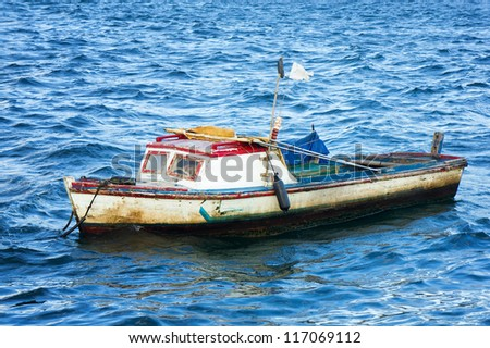 Small fishing boat anchored in the bay of Havana - stock photo