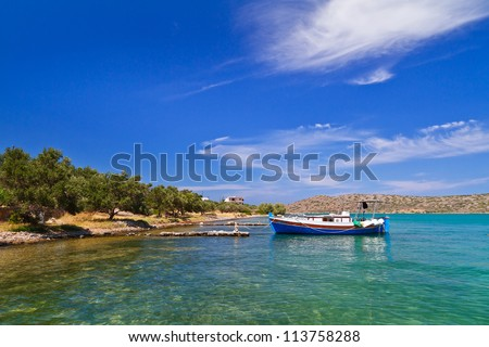 Small fishing boat at the coast of Crete, Greece