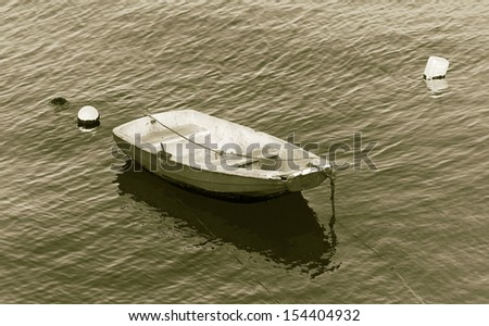 Small fishing boat floating in the fish port of Cascais - Portugal (stylized retro) - stock photo