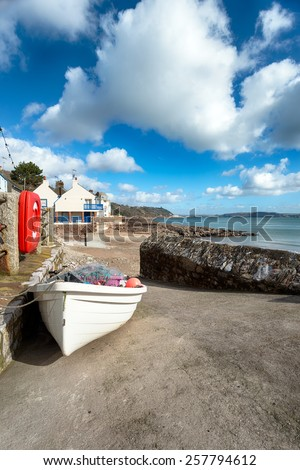 Small fishing boat laden with nets on the slipway at Kingsand on the Rame peninsula on the south east coast of Cornwall - stock photo