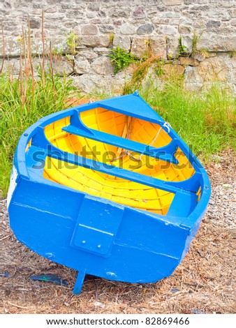 Small fishing boat moored on the edge of the water at Findhorn, Scotland